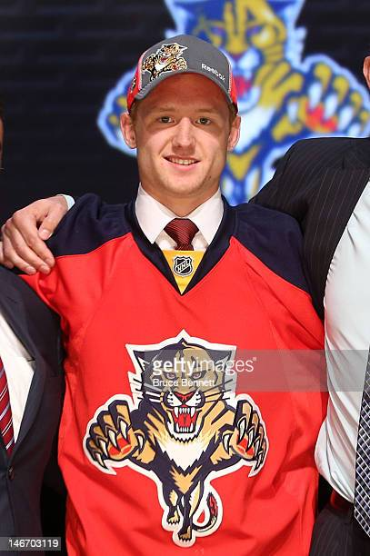 Michael Matheson 23rd overall pick by the Florida Panthers poses on stage during Round One of the 2012 NHL Entry Draft at Consol Energy Center on...