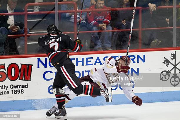 Michael Matheson of the Boston College Eagles collides with Mike McMurtry of the Northeastern University Huskies during NCAA hockey action at...