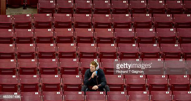 Michael Matheson of the Boston College Eagles sits in the stands before NCAA hockey against the Vermont Catamounts at Kelley Rink on February 13,...