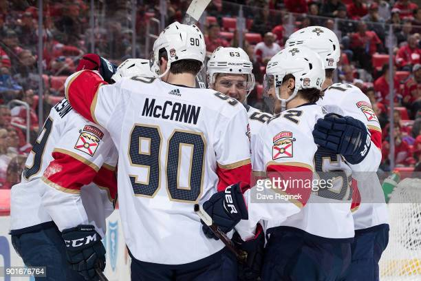 Michael Matheson of the Florida Panthers celebrates his second period goal with teammates Jared McCann Evgenii Dadonov and Denis Malgin during an NHL...