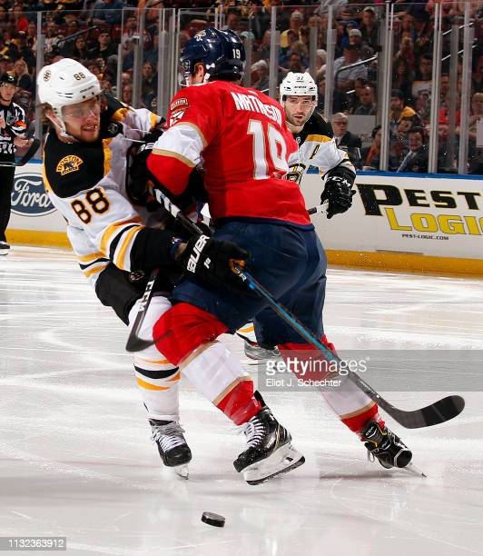 Michael Matheson of the Florida Panthers collides with David Pastrnak of the Boston Bruins at the BBT Center on March 23 2019 in Sunrise Florida