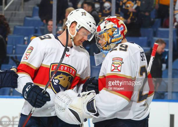 Michael Matheson of the Florida Panthers congratulates Harri Sateri after their 42 victory against the Buffalo Sabres during an NHL game on February...