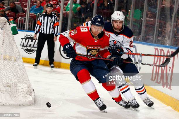 Michael Matheson of the Florida Panthers skates for possession against Leon Draisaitl of the Edmonton Oilers at the BBT Center on March 17 2018 in...
