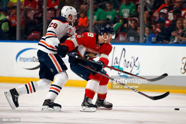 Michael Matheson of the Florida Panthers tangles with Leon Draisaitl of the Edmonton Oilers at the BBT Center on March 17 2018 in Sunrise Florida