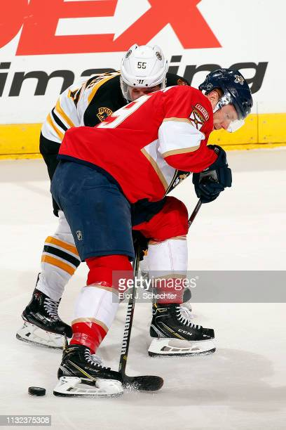 Michael Matheson of the Florida Panthers tangles with Noel Acciari of the Boston Bruins at the BBT Center on March 23 2019 in Sunrise Florida