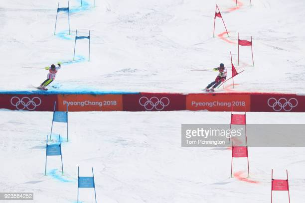 Michael Matt of Austria and Ramon Zenhaeusern of Switzerland compete during the Alpine Team Event Big Final on day 15 of the PyeongChang 2018 Winter...