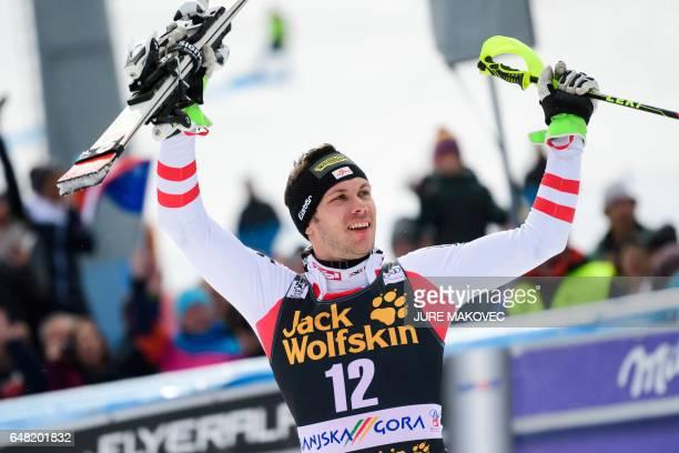 Michael Matt of Austria celebrates after winning in the FIS World Cup men's slalom race in Kranjska Gora Slovenia on March 5 2017 / AFP PHOTO / Jure...