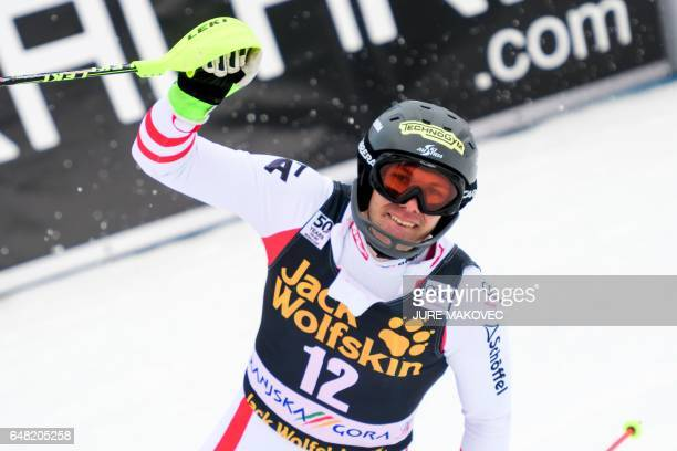 Michael Matt of Austria raises an arm in the finish area during the FIS World Cup men's slalom race in Kranjska Gora Slovenia on March 5 2017 / AFP...