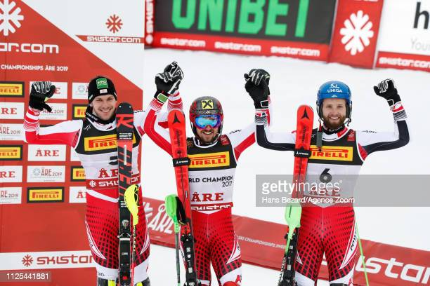 Michael Matt of Austria wins the silver medal Marcel Hirscher of Austria wins the gold medal Marco Schwarz of Austria wins the bronze medal during...
