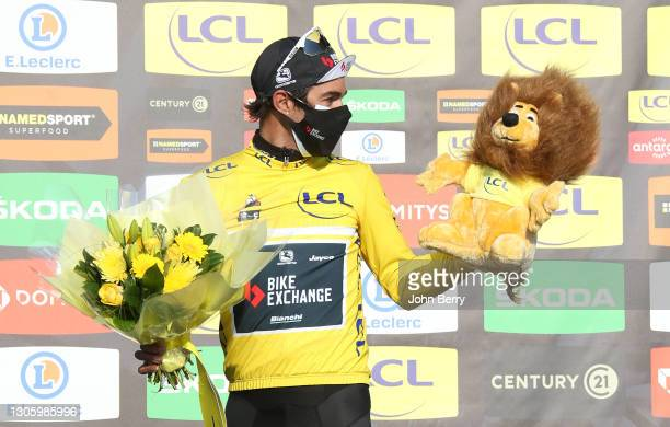 Michael Matthews of Australia and Team BikeExchange wears the leader's yellow jersey during the podium ceremony after stage 2 between...