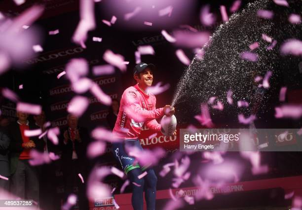 Michael Matthews of Australia and team Orica-GreenEDGE sprays champagne in celebration after retaining the Maglia Rosa leader's jersey following the...