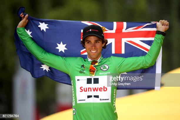 Michael Matthews of Australia riding for Team Sunweb celebrates on the podium after winning the green points jersey of the 2017 Le Tour de France on...
