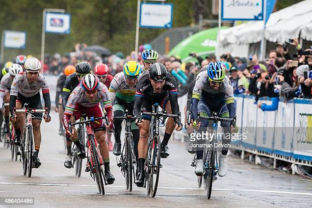 Michael Matthews of the ORICAGreenEDGE team narrowly wins over Nikias Arndt of Team GiantAlpecin in second place and Aleksei Tcatevich of Team...