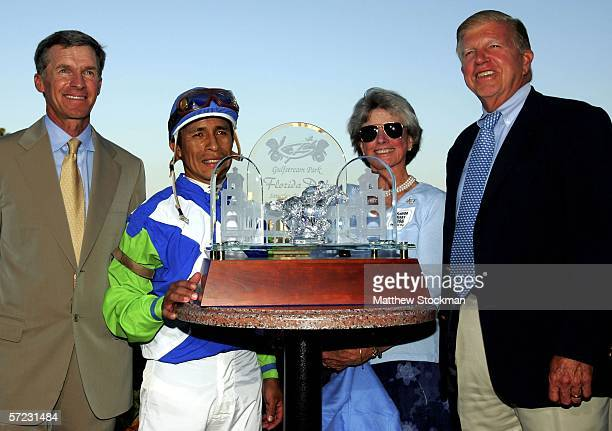 Michael Matz trainer of Barbaro jockey Edgar Prado and owners Gretchen and Roy Jackson pose in the winner's circle after winning the Florida Derby...