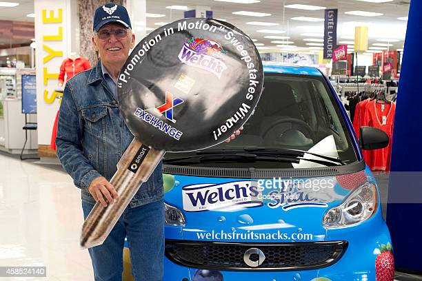 Michael Mauldwin receives a new Smart Car from the makers of Welch's Fruit Snacks for winning the Promotion In Motion sweepstakes at Sheppard Air...