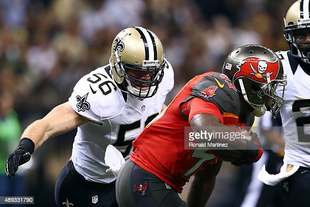 Michael Mauti of the New Orleans Saints pursues Bobby Rainey of the Tampa Bay Buccaneers during the third quarter of a game at the MercedesBenz...