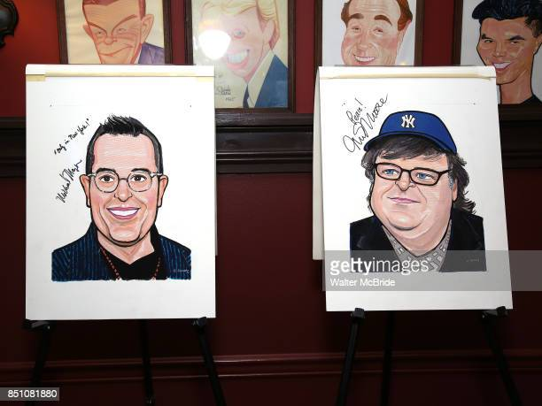 Michael Mayer and Michael Moore portraits during the Michael Moore and Michael Mayer portrait unveilings as they join the Wall of Fame at Sardi's on...