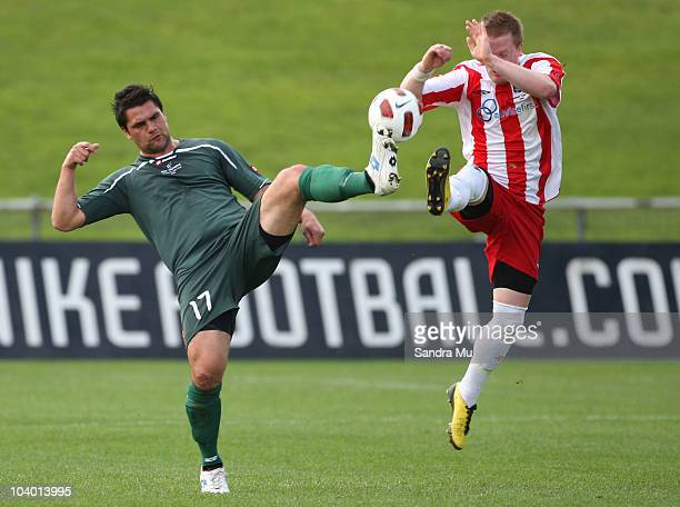 Michael Mayne of Bay Olympic and Michael White of Miramar contest for the ball during the Chatham Cup Final between Bay Olympic and Miramar Rangers...