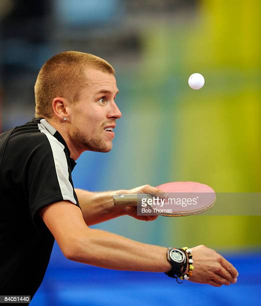 Michael Maze of Denmark playing against Zoran Primorac of Croatia during their men's table tennis single preliminary match during Day 12 of the...