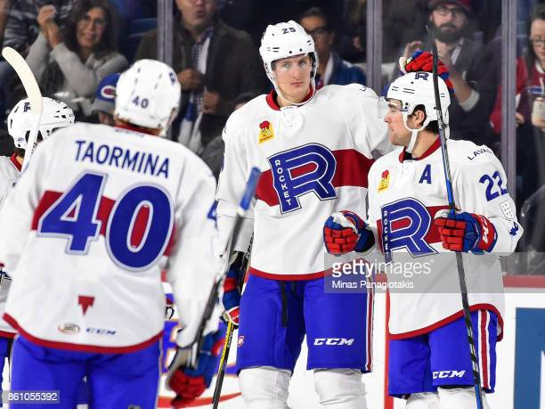 Michael McCarron of the Laval Rocket celebrates a first period goal by teammate Chris Terry against the Binghamton Devils during the AHL game at...