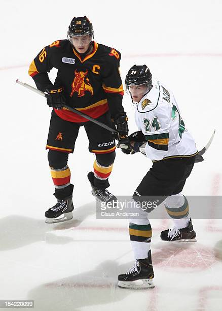 Michael McCarron of the London Knights skates against Brendan Gaunce of the Belleville Bulls during an OHL game at the Budweiser Gardens on October...