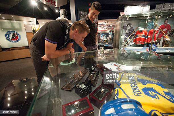 Michael McCarron of the Montreal Canadiens and Brendan Perlini of the Arizona Coyotes view championship rings during a tour of the Hockey Hall of...