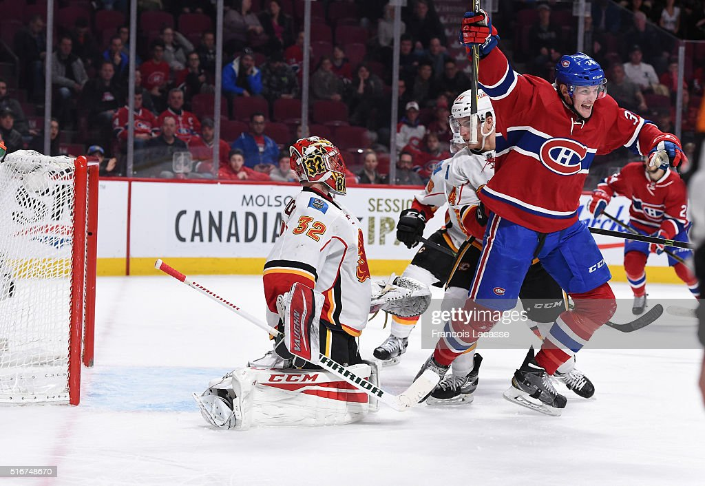 Michael McCarron #34 of the Montreal Canadiens celebrates after scoring a goal against the Calgary Flames in the NHL game at the Bell Centre on March 20, 2016 in Montreal, Quebec, Canada.