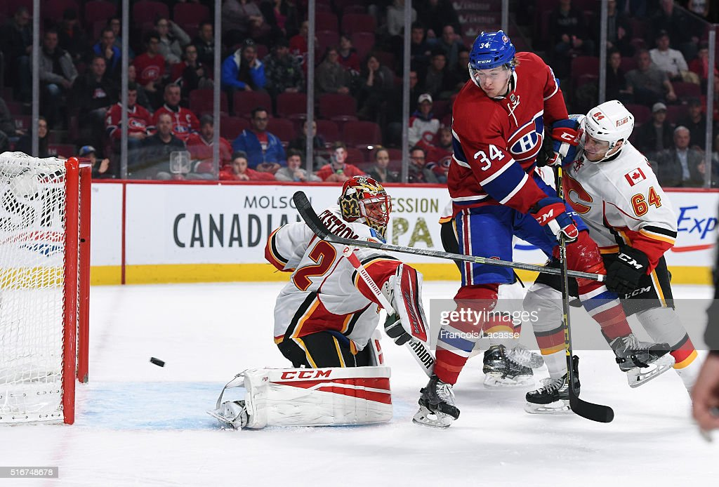Michael McCarron #34 of the Montreal Canadiens scores a goal against Niklas Backstrom #32 of the Calgary Flames in the NHL game at the Bell Centre on March 20, 2016 in Montreal, Quebec, Canada.