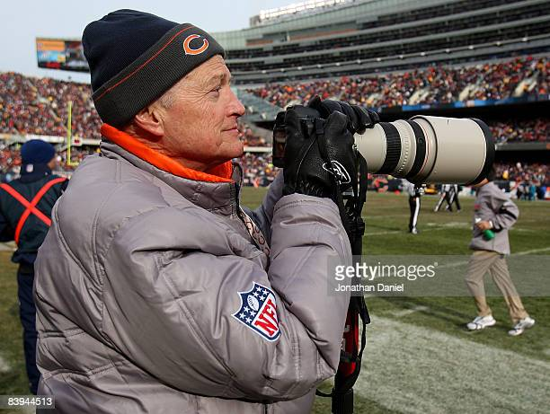 Michael McCaskey Chariman of the Board of the Chicago Bears tries his hand at sideline photography during a game between the Bears and the...