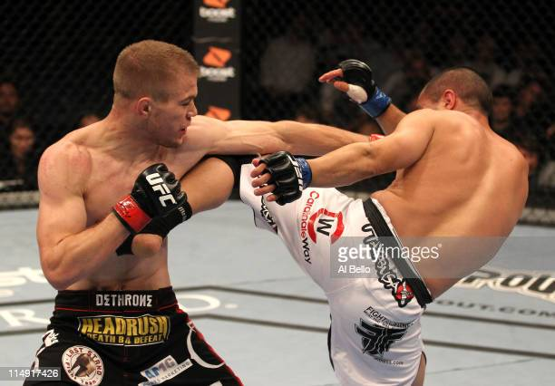 Michael McDonald and Chris Cariaso trade strikes during their bantamweight fight at UFC 130 at the MGM Grand Garden Arena on May 28, 2011 in Las...
