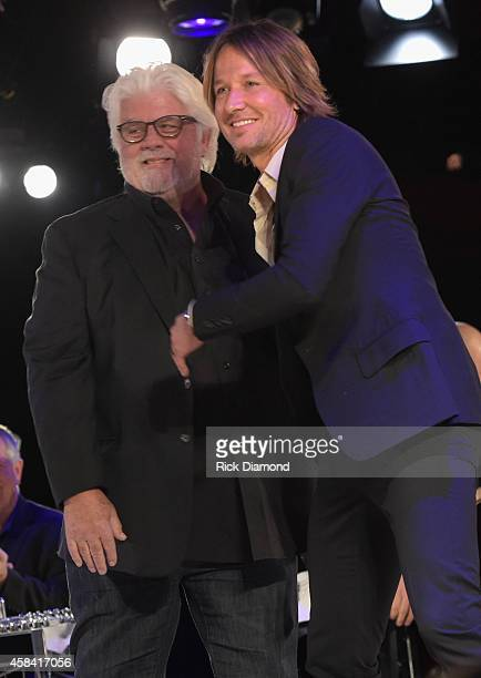Michael McDonald and Keith Urban speak onstage at the BMI 2014 Country Awards at BMI on November 4 2014 in Nashville Tennessee