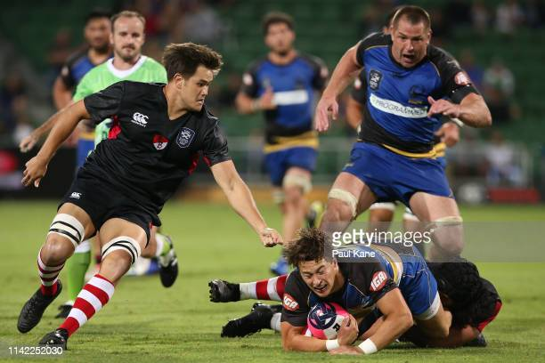 Michael McDonald of the Force gets tackled by Latiume Fosita of the Dragons during the Rapid Rugby match between the Western Force and the Asia...