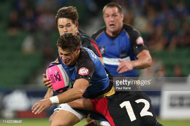 Michael McDonald of the Force runs the ball during the Rapid Rugby match between the Western Force and the Asia Pacific Dragons at HBF Stadium on...