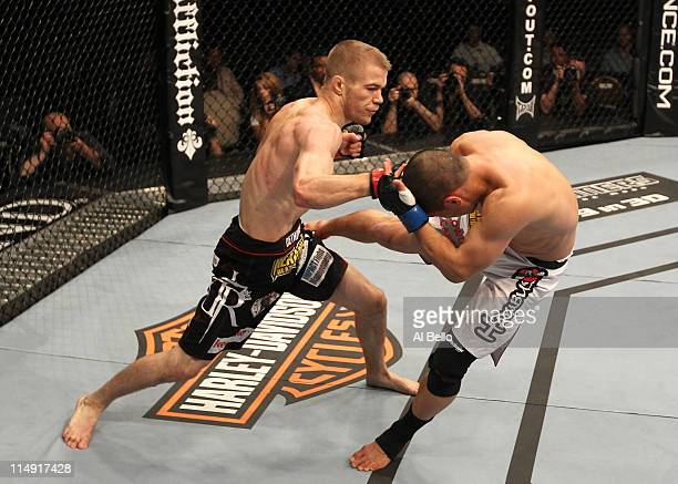 Michael McDonald punches Chris Cariaso during their bantamweight fight at UFC 130 at the MGM Grand Garden Arena on May 28, 2011 in Las Vegas, Nevada.