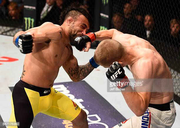 Michael McDonald punches John Lineker in their bantamweight bout during the UFC Fight Night event on July 13 2016 at Denny Sanford Premier Center in...