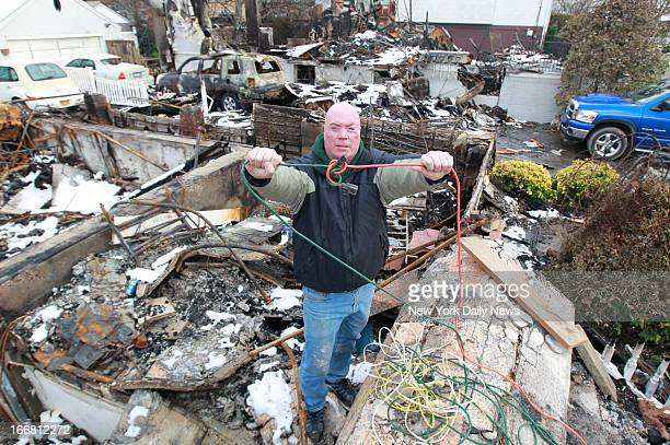 Michael McDonnell poses for pictures at the burn down homes where he saved 6 lives located at 250 and 258th Beach 130th Street in Rockaway McDonnell...
