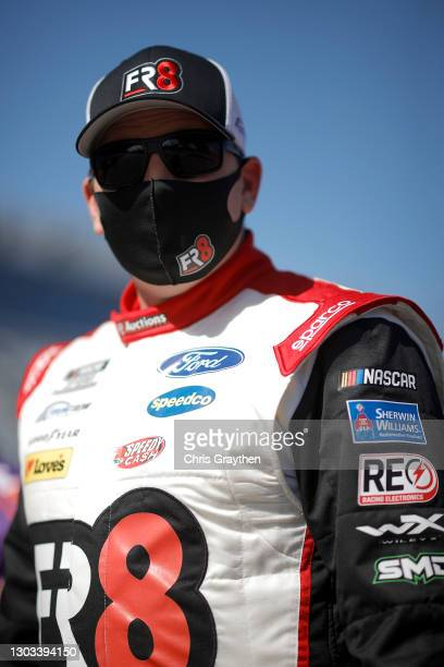 Michael McDowell, driver of the Love's Travel Stop Ford, waits the grid prior to the NASCAR Cup Series O'Reilly Auto Parts 253 at Daytona...