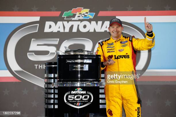 Michael McDowell, driver of the Love's Travel Stops Ford, celebrates in victory lane after winning the NASCAR Cup Series 63rd Annual Daytona 500 at...