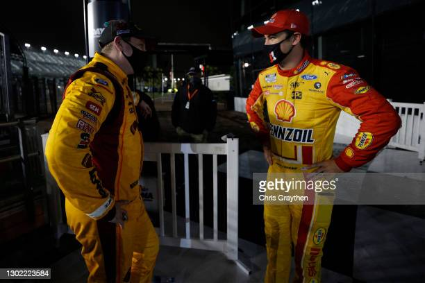 Michael McDowell, driver of the Love's Travel Stops Ford, talks to Joey Logano, driver of the Shell Pennzoil Ford, in Victory Lane after winning the...