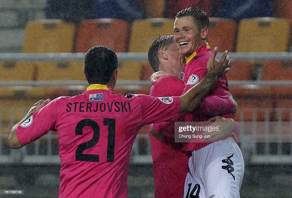 Michael McGlinchey of Central Coast Mariners celebrates with Mile Sterjovski after score during the AFC Champions League Group H match between Suwon Bluewing and Central Coast Mariners at Suwon World Cup Stadium on April 23, 2013 in Suwon, South Korea.