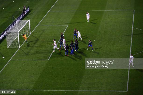 Michael McGlinchey of New Zealand shoots and scores from a freekick against goal keeper Phillip Mango of Solomon Islands during the 2018 FIFA World...
