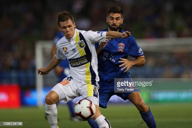 Michael McGlinchey of the Central Coast Mariners contests the ball with Nick Cowburn of Newcastle Jets during the round 15 ALeague match between the...