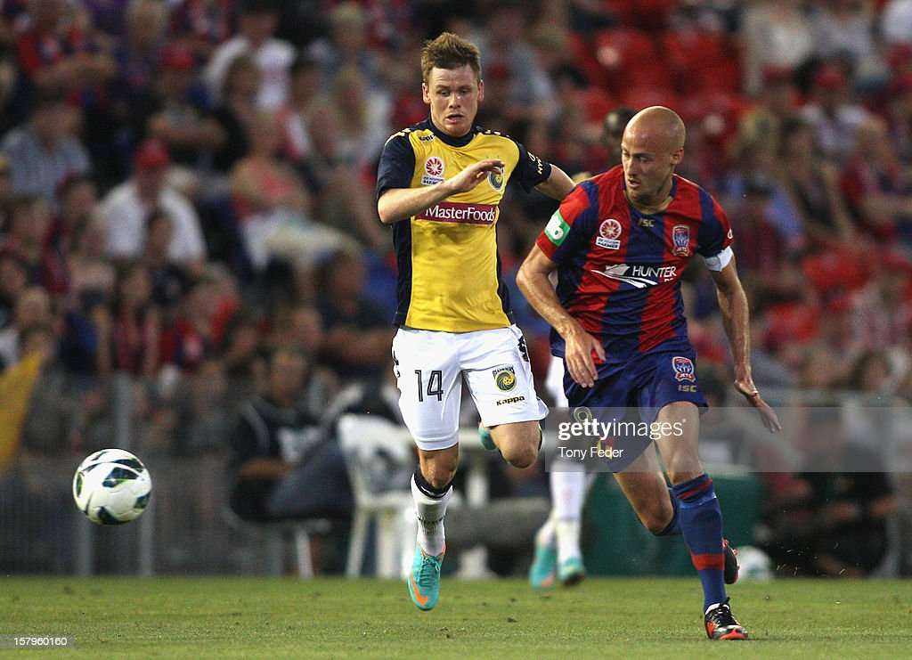 Michael McGlinchey of the Mariners and Ruben Zadkovich of the Jets contest the ball during the round ten A-League match between the Newcastle Jets and the Central Coast Mariners at Hunter Stadium on December 8, 2012 in Newcastle, Australia.