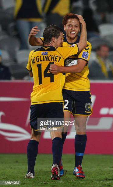 Michael McGlinchey of the Mariners celebrates with Mustafa Amini of the Mariners after Amini scored a goal during the AFC Asian Champions League...