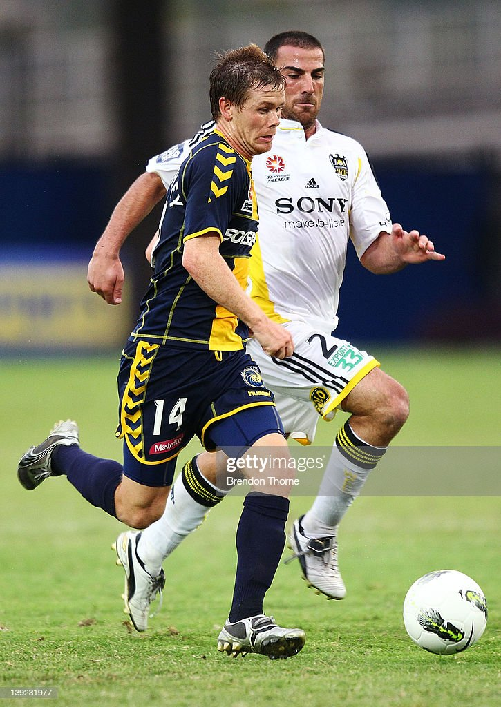 Michael McGlinchey of the Mariners competes with Emmanuel Muscat of the Phoenix during the round 20 A-League match between the Central Coast Mariners and the Wellington Phoenix at Bluetongue Stadium on February 18, 2012 in Gosford, Australia.