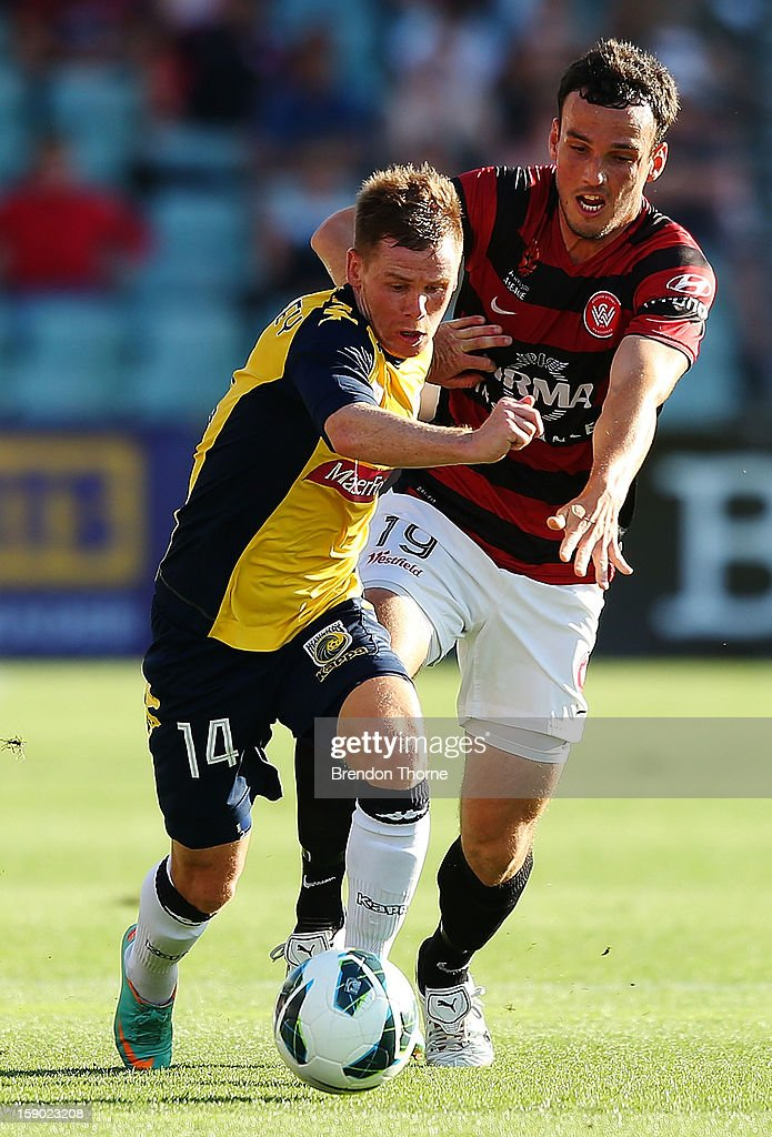 Michael McGlinchey of the Mariners competes with Mark Bridge of the Wanderers during the round 15 A-League match between the Western Sydney Wanderers and the Central Coast Mariners at Parramatta Stadium on January 6, 2013 in Sydney, Australia.
