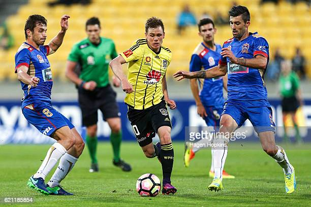 Michael McGlinchey of the Phoenix attempts to beat the Jets defence during the round five ALeague match between the Wellington Phoenix and the...