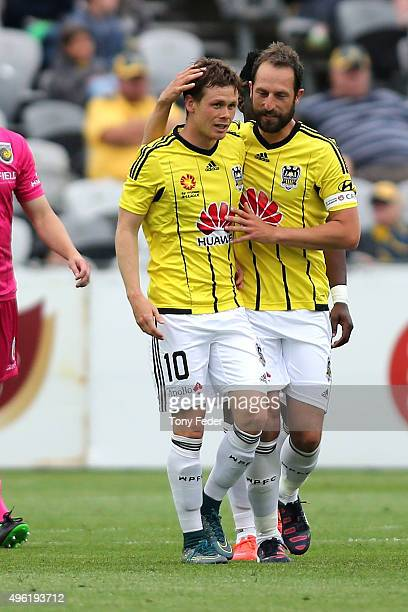 Michael McGlinchey of the Phoenix celebrates a goal with a team mate during the round five A-League match between the Central Coast Mariners and the...