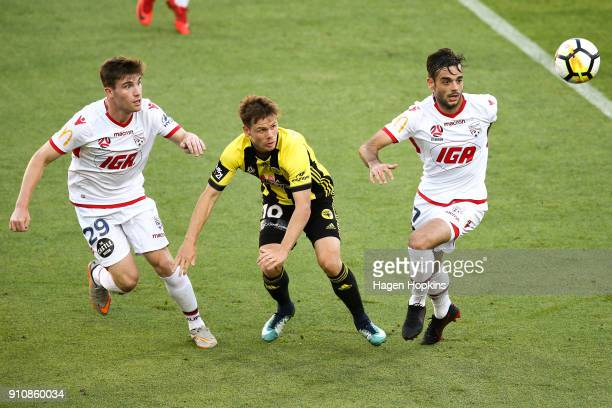 Michael McGlinchey of the Phoenix compete for the ball with Ryan Strain and Nikola Mileusnic of Adelaide United during the round 18 ALeague match...