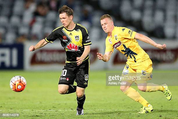 Michael McGlinchey of the Phoenix is chased by Jacob Poscoliero of the Mariners during the round 13 ALeague match between the Central Coast Mariners...